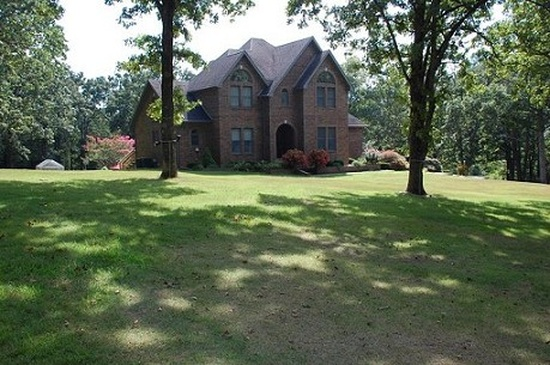 13. 208 Rader Dr, West Plains, MO 65775.  This custom built brick home has 5,000 square feet of living space, 5 bedrooms, 2.5 bathrooms, and sits on 6.75 acres.  For $699,900, it also features an in-ground pool, enormous patio, fireplace and wet bar, as well as a walkout finished basement.