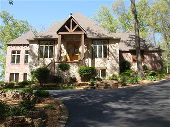 14. 2072 N 23rd Ave, Ozark, MO 65721. $699,900 will get you this 4 bedroom, 2.5 bathroom home with 4,472 square feet of living space.  It is in a gated community with access to Finley River and features fireplaces, a screened in porch, a deck with waterfalls, a wet-bar and a 3-car garage.
