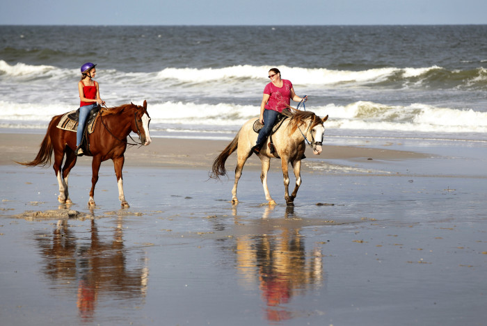 1. Ride off into the sunset on a romantic horseback ride.
