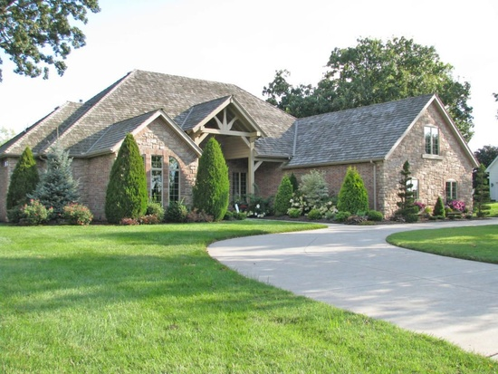 15. 3934 E Eaglescliffe Dr, Springfield, MO 65809.  With 4,263 square feet of living space, this 4 bedroom, 4 bathroom home features a backyard pond, terraced patio, office, enclosed porch, hot tub, fireplace and 3-car garage.