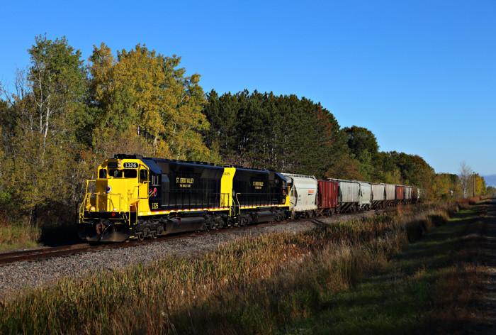 15. 40 cars headed for North Branch in the afternoon sun.