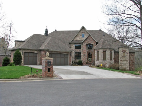 2. 725 S Hickory Terrace, Springfield, MO 65809.  For $709,000, you can get this HUGE 7,000 square foot home with 6 bedrooms and 5 bathrooms!  This home is also located on a gorgeous private 3-hole golf course in a gated community and a has a full finished basement that is a living space all on its own at  2430 square feet.