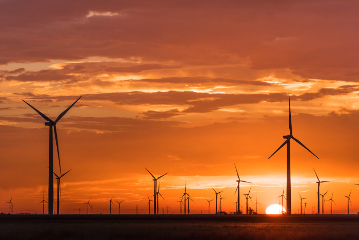 11) The garden of windmills in Lubbock, Texas awakens with the radiant orange sun.