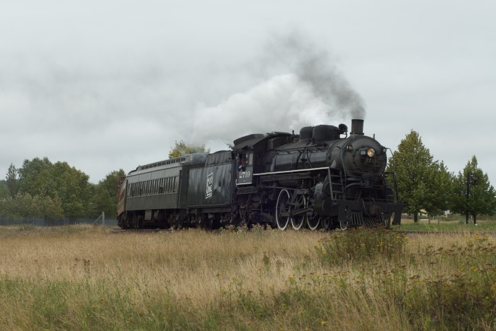 1. Soo Line Engine 2719 of the North Shore Scenic Railroad heads into Two Harbors billowing steam.