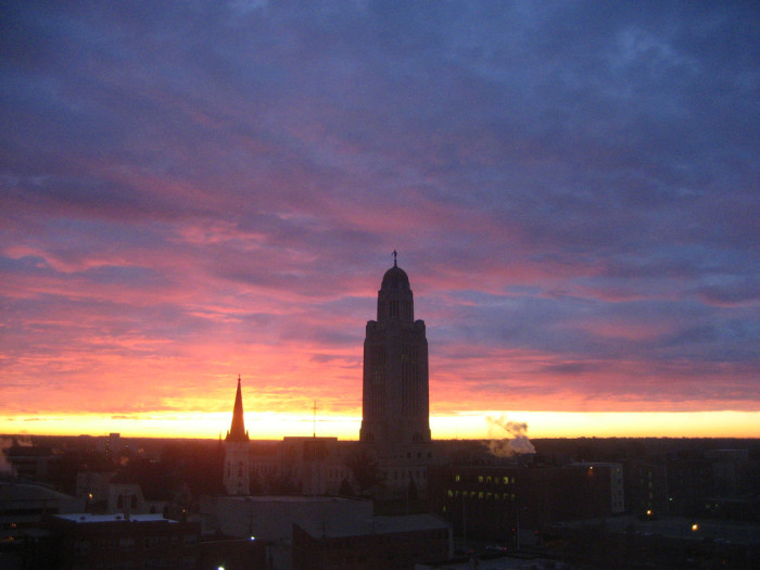 14. The Sun Rising Behind the Capitol Building in Lincoln