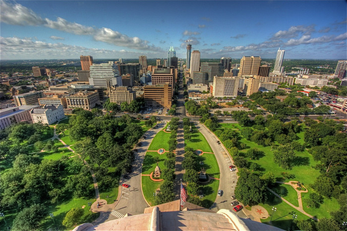 6) This photo captures the perfect balance between the abundant greenery and towering buildings of Austin.