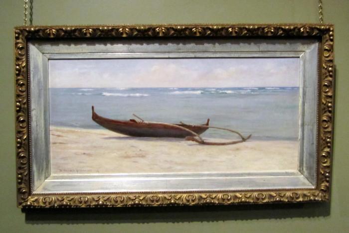 4) A framed beach photograph.