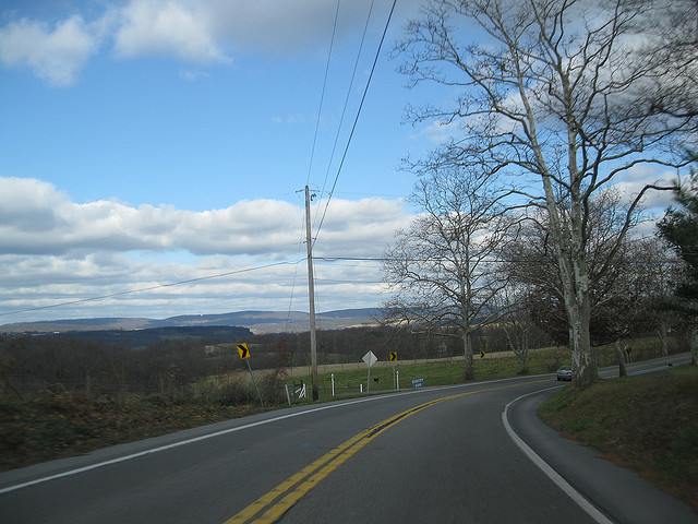 8. In Millersburg, State Route 147 offers you a vast view of fields and far away mountains.