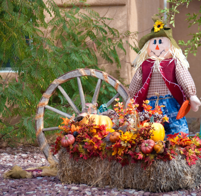 10) Everyone's lawns are decorated with cute fall must-haves like scarecrows and squares of hay.