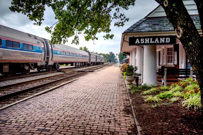 10. An Amtrak train makes a stop at the historic Ashland Train Station.