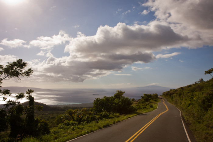6) Catch a sunset while on Kula Road, with a view of the West Maui Mountains in the background.