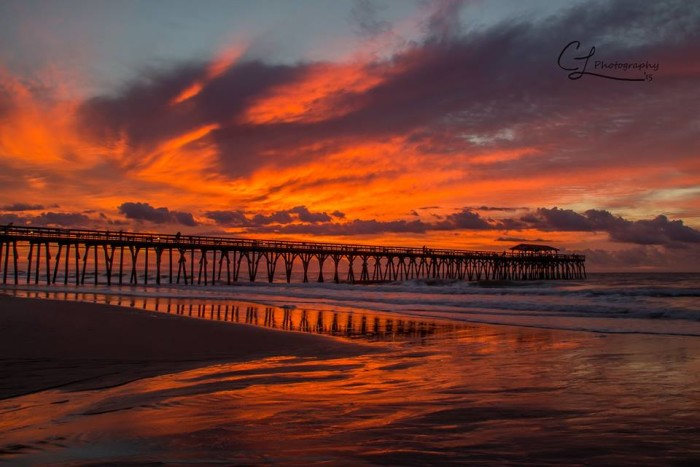 14. An epic fiery sunrise caught by Chuck Lawhon at Myrtle Beach State Park.