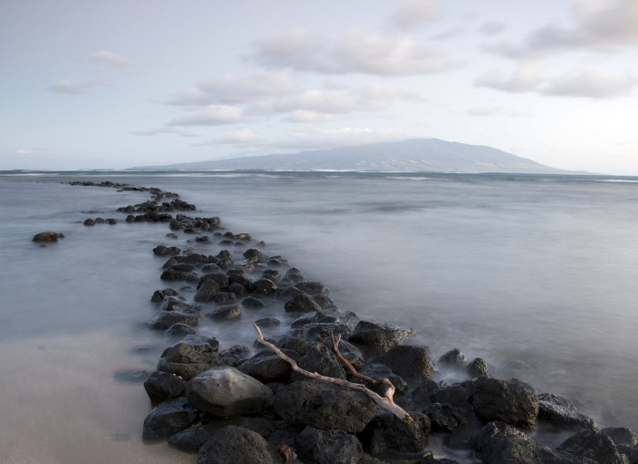 11) Maui as pictured from an ancient fishpond near Pauwalu, on Molokai; the cool rock formation totally makes this photograph, don't you think?