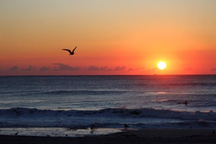 14. A sunrise in Seaside, taken by Nancy Shive Sullivan.
