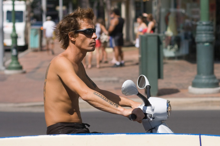 11) The moped rider.