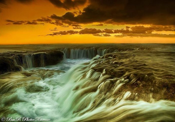 10) The stunning golden sky and cascading water makes this photograph, taken by Bmr PhotoeXtreme Rodrigues, feel out of this world.