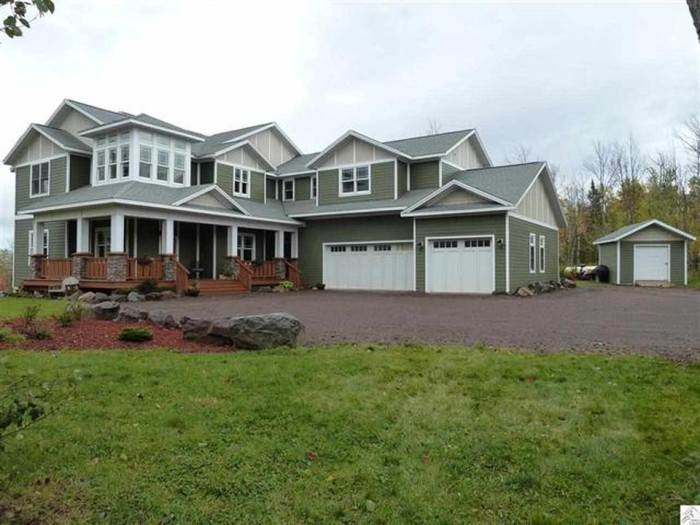 3. This massive home in Two Harbors has 5 beds, 4 baths, and beautiful views of Superior for $649,900.
