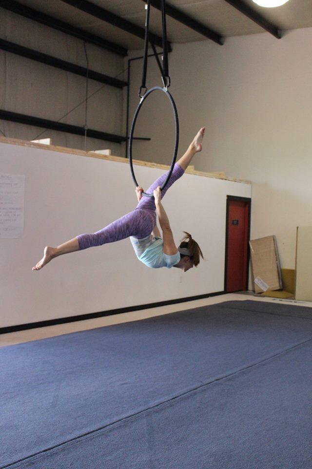 3. Take an aerial yoga class