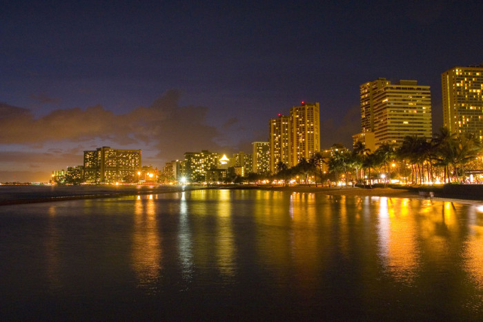 1) The lights of Waikiki reflect off the beautiful Pacific Ocean.