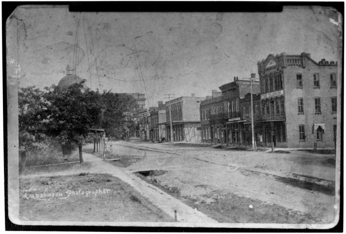 10. The Old Capitol Building stands in the background in this shot of 1890's Jackson.