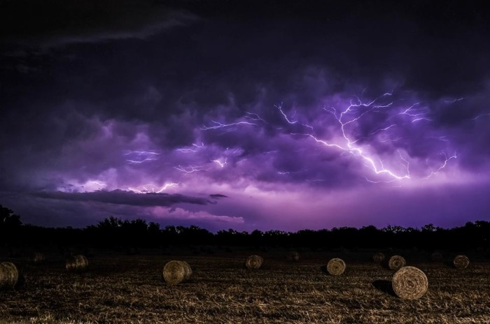 8) Incredibly eerie, foreboding shot of lightning strikes over a field of hay bales in Waco, Texas. Taken by Alex Brouwer.