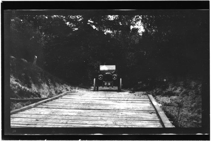 11. An automobile crosses a wooden bridge in Meridian in August of 1916.