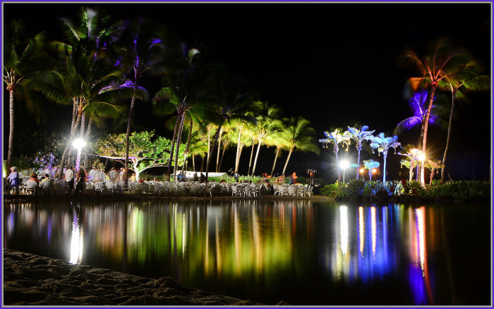 11) Colored lights shoot through the palm trees at the Grand Hyatt in Poipu.
