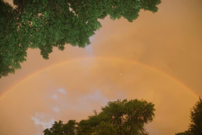 10. A subtle - but still impressive - early morning rainbow against a gloomy sky.