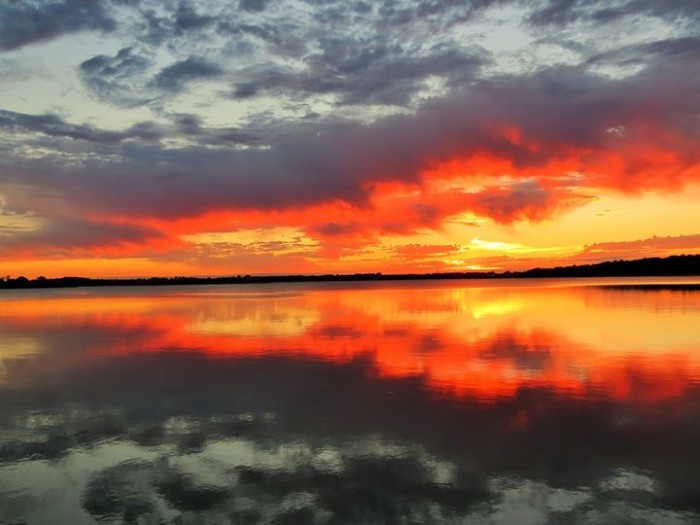 7. Terry Carr captured this gorgeous photo of the sun setting over Pelican Lake in Ashby.