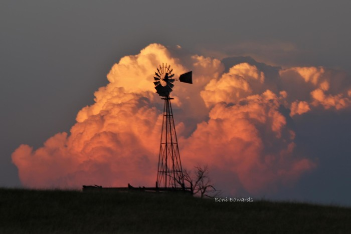 13. A windmill stands proudly in front of huge, fluffy clouds near North Platte. Photo by Boni Edwards.