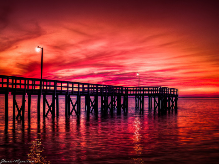 4. A powerful sunset overlooking Bayfront Park Pier in Daphne, Alabama.