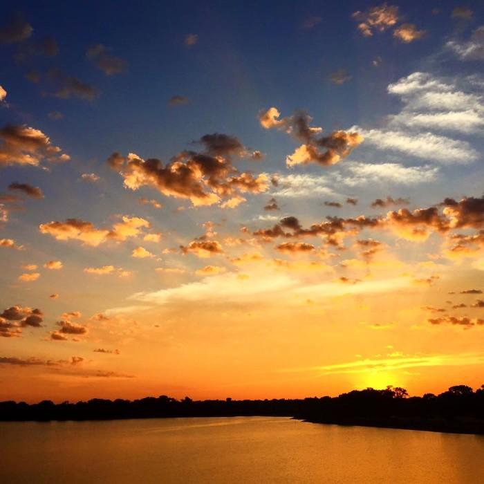 9. The sun turns the sky a vibrant orange over Conestoga Lake.