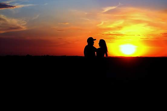 23. The look of love is captured by Vickie O'Neal in front of a sunset near Scribner.