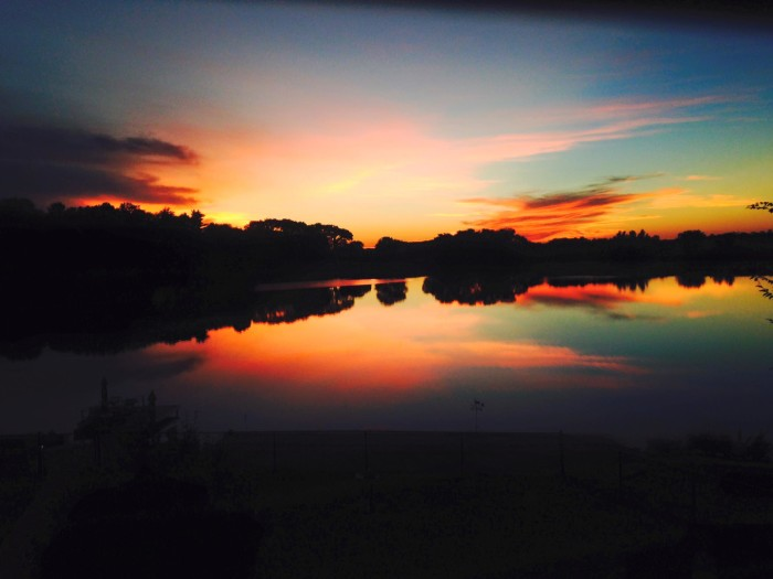 12. A copper-colored sunset is reflected in the water at Copper Dollar Cove near Plattsmouth.