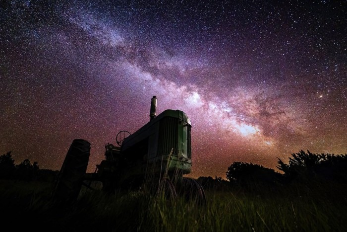 9. We've shown you this one before...but it's spectacular and deserves another look. The Milky Way spills across the sky over a tractor near Roca.