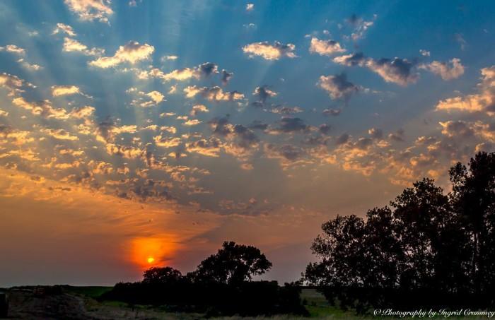 11. An illuminating sunset lights up popcorn clouds.