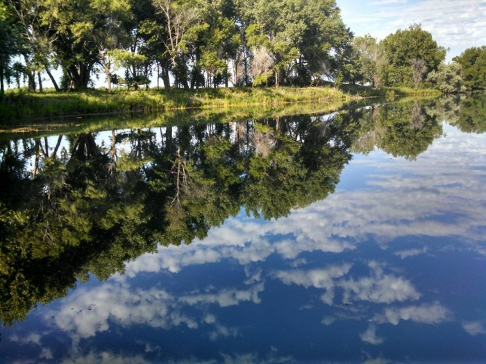 3. Sandy Channel in mid-summer reflects the bright green vegetation and clear blue sky.