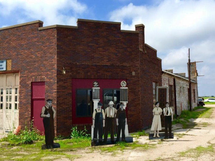 1. A group of wooden cutout villagers greet visitors in Rogers, resembling the wooden people that can also be found in Taylor.