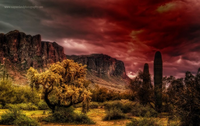 11. And here's a look at another storm (perhaps the same one) brewing over the Superstition Mountains. That red hue makes it look especially threatening.