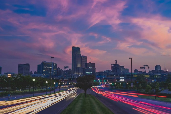 3. A gorgeous long-exposure shot shows cars zooming by outside of downtown Omaha just after sunset.
