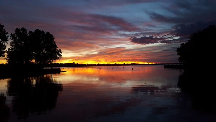 19. Just imagine wrapping up in a warm blanket with someone you love, watching this sunset over Branched Oak Lake.