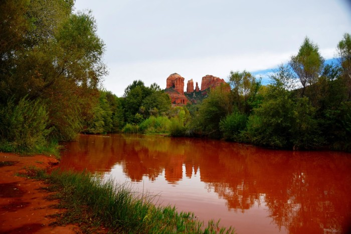 14. This is what Oak Creek looked like after the storm cleared on Tuesday. The water is so red!