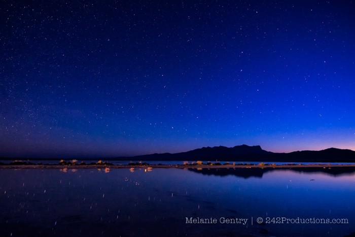 16) Wow! Melanie also captures a blue starry sky reflected over the water at the rain-filled salt basin in Guadalupe Mountains National Park!