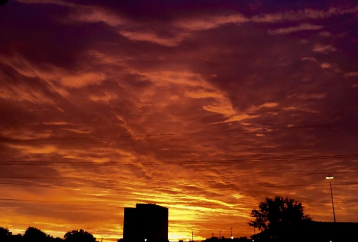 13) The sun awakens over Plano, TX, painting the sky gorgeous hues of red and yellow. Taken by Shane Allen.