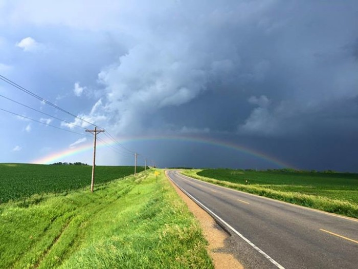 5. This rainbow adds a splash of color to a cloudy sky.