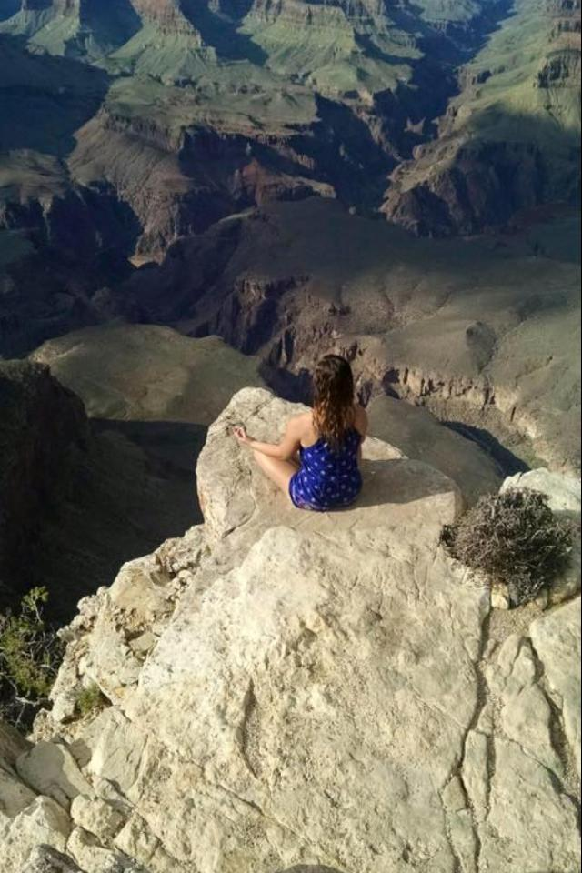 13. Here's a photo of a reader finding solitude at the Grand Canyon. A little too close to the edge for me!