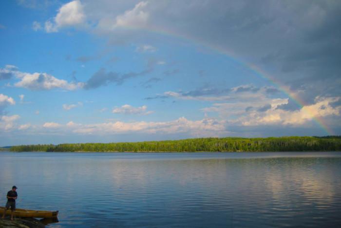 7. Crane Lake looks wonderful under a long rainbow.