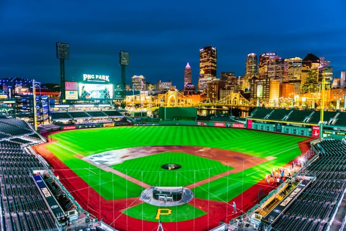 16. You can see the illuminated Pittsburgh skyline behind PNC Park.