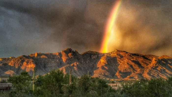 13. Here is another pretty, though faint, rainbow over Sedona's red rocks.