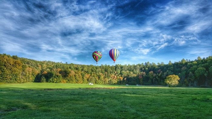 18) The two ballons on the horizon were shot by Christopher Hatch.